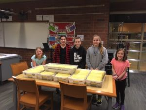 5 students standing behind boxes of mailer