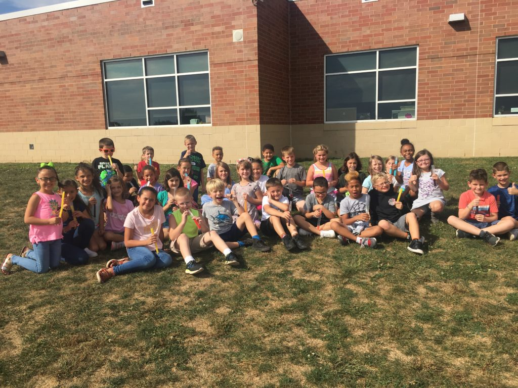 class outside with popsciles