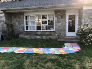 walkway to house decorated with chalk