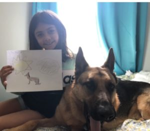 Girl with her dog and picture of her dog