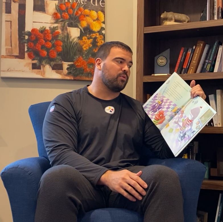 Stefen Wisniewski reading a book